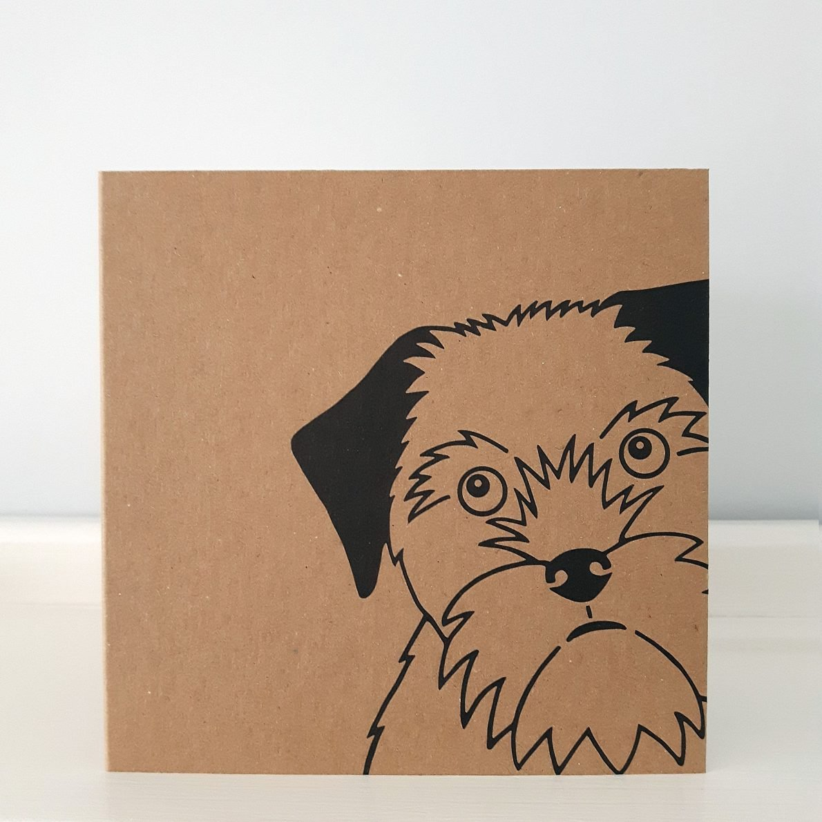border terrier card. borwn kraft with close up of border terrier's face
