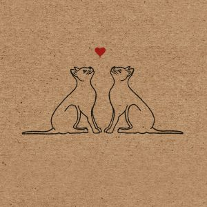 Close up of love cats design - a pair of black cats looking up toward a heart