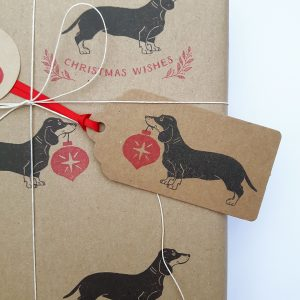 Dachshund Christmas gift wrapping, close up on dachshund christmas gift tag