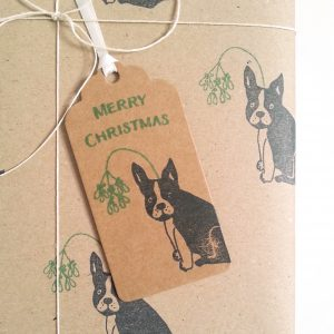 close up of gift wrapped present, showing French Bulldog Christmas gift tag