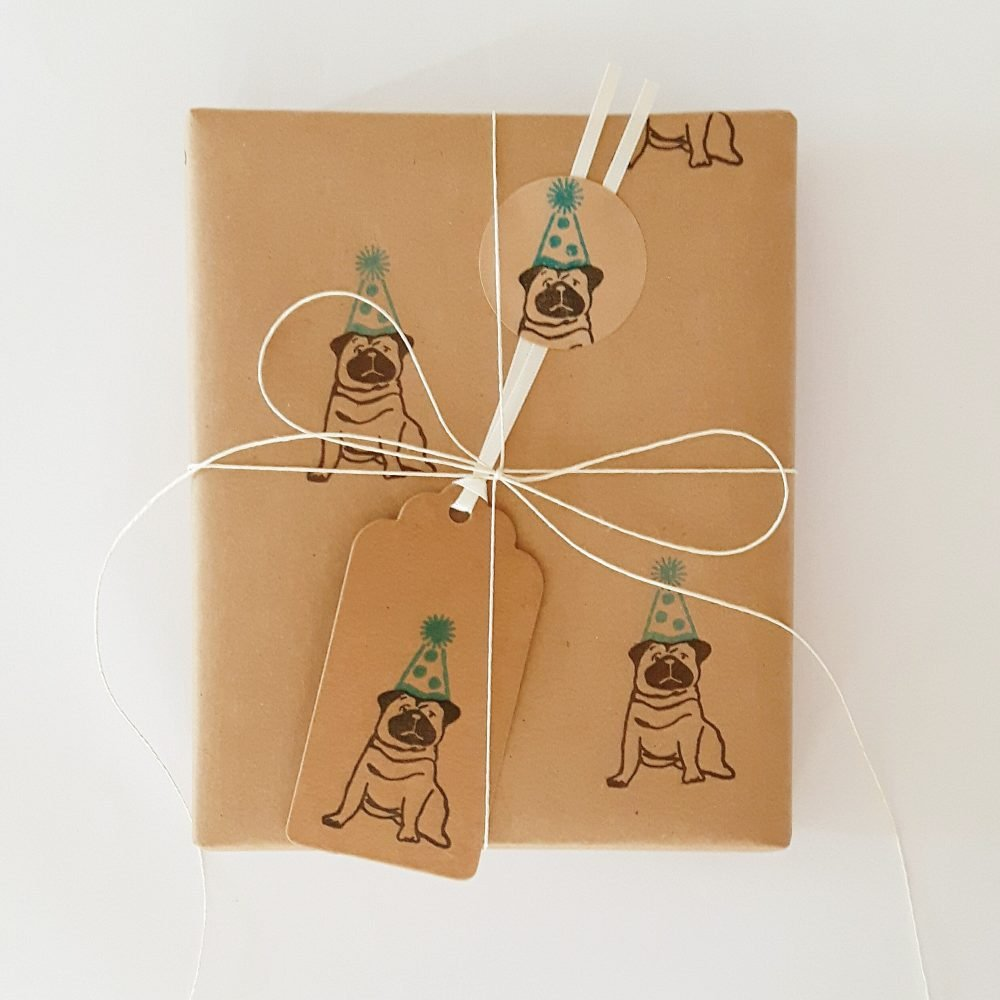 present wrapped in birthday pug wrapping paper