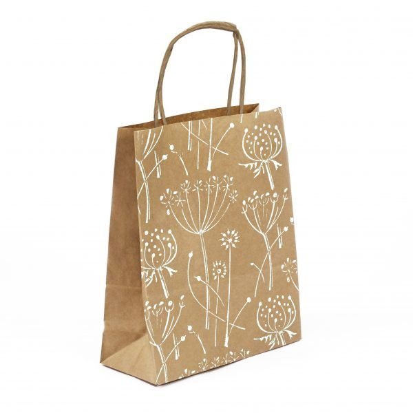 small floral gift bag. Brown kraft bag with white floral print.
