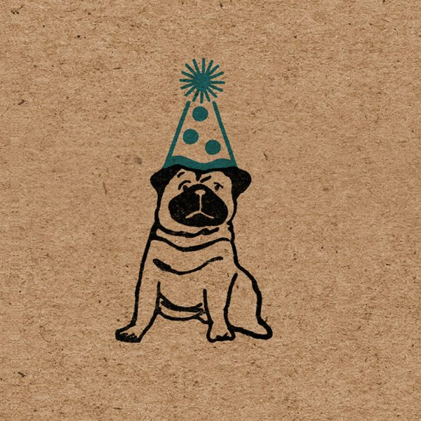close up of design on birthday pug wrapping paper - one black pug on brown kraft background, wearing blue party hat