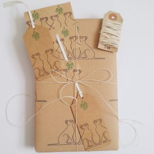 Prestn gift wrapped using recyclable wrapping paper with Christmas Cat design - black cats and mistletoe on recycled kraft paper