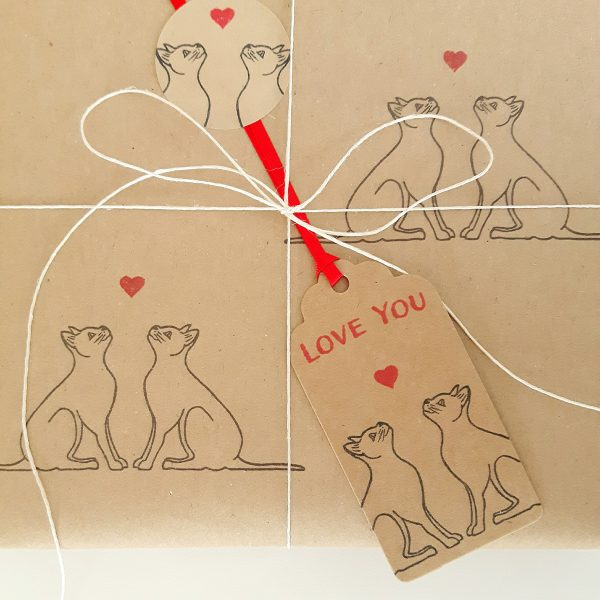 close up of love cats gift tag, on wrapped present