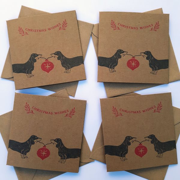 Dachshund Christmas card set, showing 4 kraft cards, with matching kraft envelopes