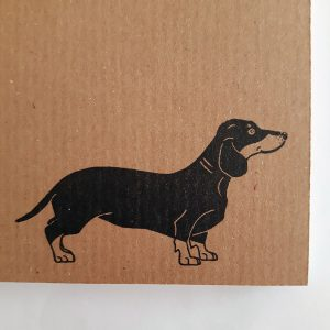close up of dachshund print on bottom right corner of kraft sausage dog notebook