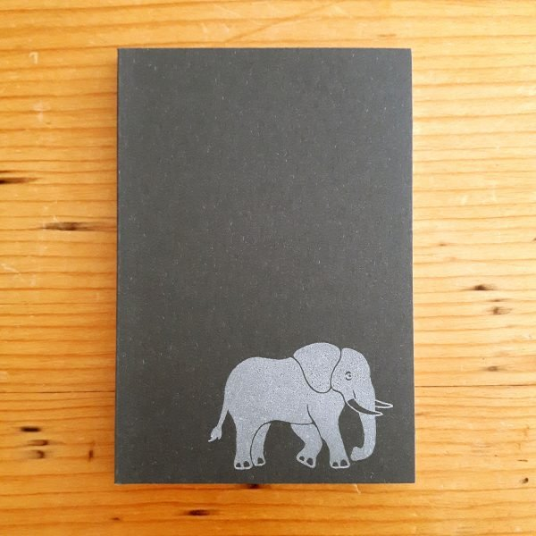 elephant notebook. small charcoal grey notebook, with white elephant in bottom right corner