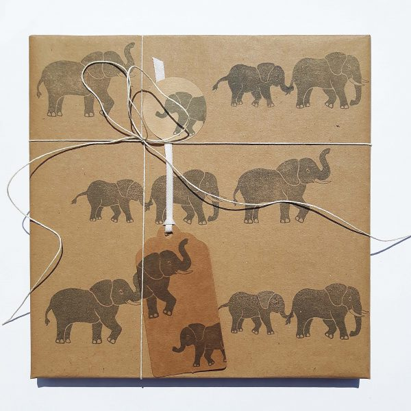 Elephant gift tag, attached to present wrapped in matching paper