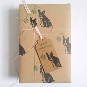 Christmas gift, gift wrapped in French bulldog christmas paper and Christmas gift tag
