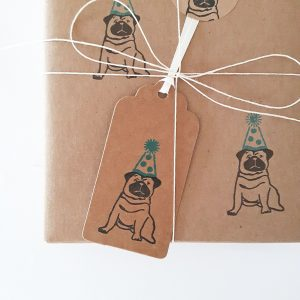 presents wrapped in party pug gift wrapping, with tag and sticker