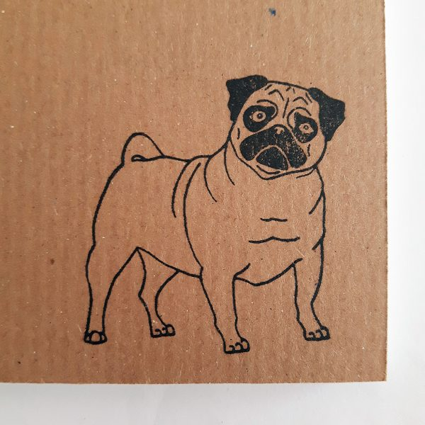 close up of pug design on ribbed kraft cover of pug notebook