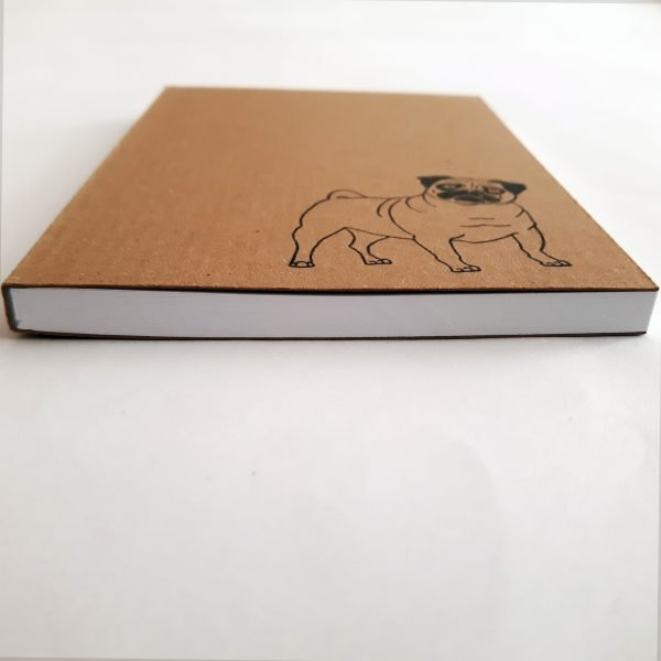 angled shot of pug notebook, showing white sheets inside the pad