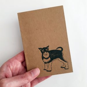 schnauzer notebook. Passport-sized brown kraft notebook, with black schanuzer print.