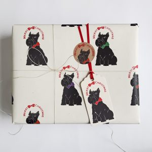 Christmas gift wrapped in Scottie Dog Christmas wrapping paper, with matching gift tag and hemp cord