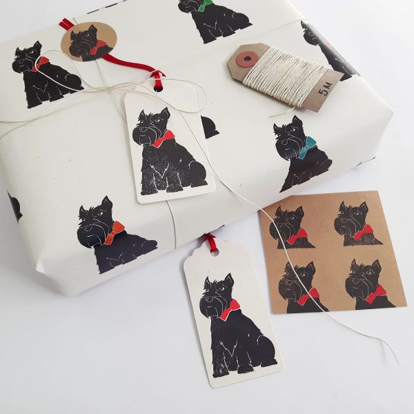 scottie dog gift wrapping, image showing gift wrapped present, with scottie dog paper, gift tags, stickers, and natural hemp cord