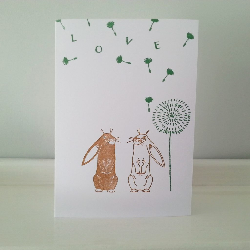 Love card with bunnies and dandelion clock and seeds