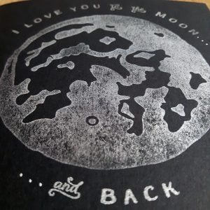Super close up of I Love You to the Moon and Back card