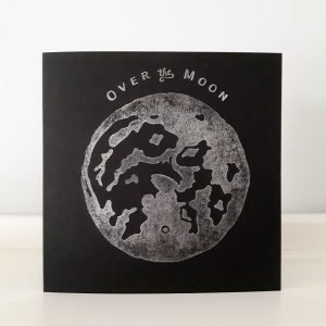 Black greeting card, with silver moon print and Over the Moon message