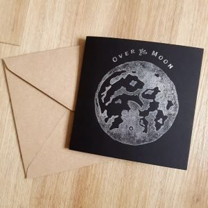 Black greeting card, with silver moon print and Over the Moon message, with kraft envelope