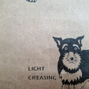 example of damage to a seconds wrapping paper sheet - light creasing on Schnauzer wrapping paper