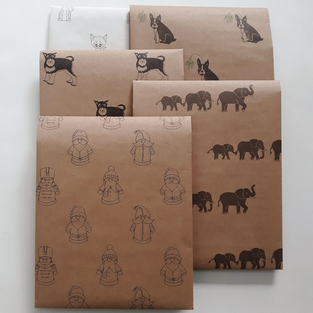 Possible combination of seconds wrapping paper sheets - santa, elephant, schnauzer, Frenchie and Cat designs