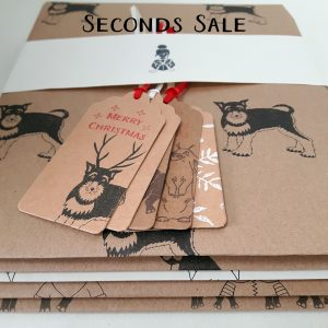 Seconds sale promotional shot, folded gift wrap sheets, and gift tags