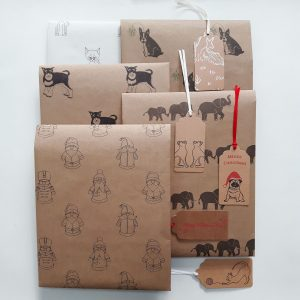 assortment of folded seconds gift wrap sheets and gift tags