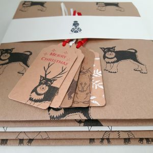 angled shot of seconds gift tags and wrapping paper sheets