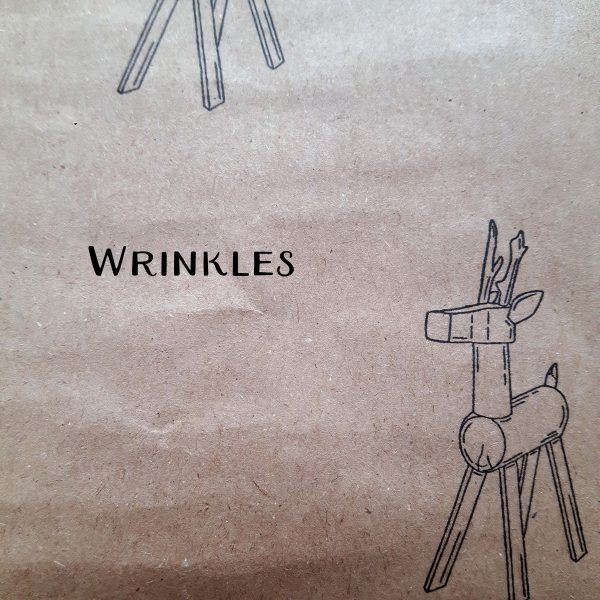 Image showing wrinkles on seconds wrapping paper sheets, reindeer design