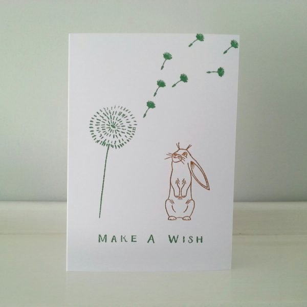 rabbit card, a bunny making a wish from a dandelion clock