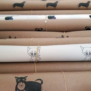 selection of wrapping paper sheets, rolled, multiple Wrapped By Alice designs.