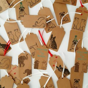 Assorted handmade kraft gift tags by Wrapped By Alice.
