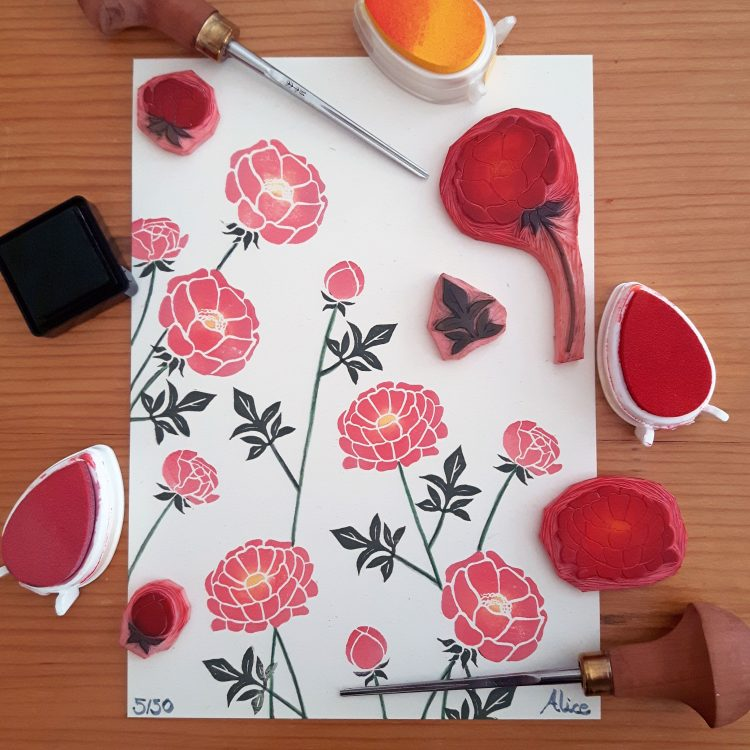 Flat lay of Wrapped By Alice peony print, showing finished print, with printing tools