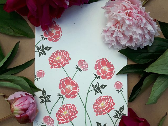 Peony Print, surrounded by real pink peonies