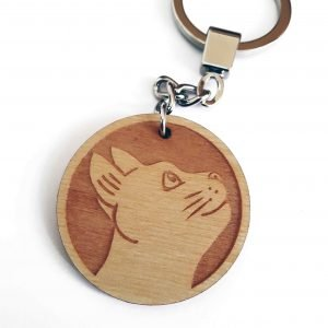 close up of cat keyring, showing wooden laser engraved charm