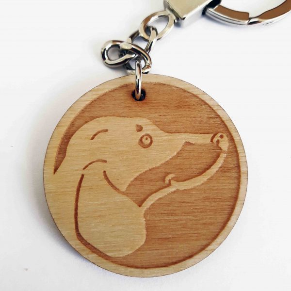 close up of sausage dog keyring, showing wooden laser engraved charm