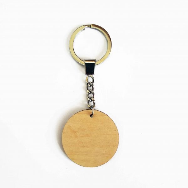 image showing reverse of my wooden laser cut keyrings, which hang from a silver tone key chain