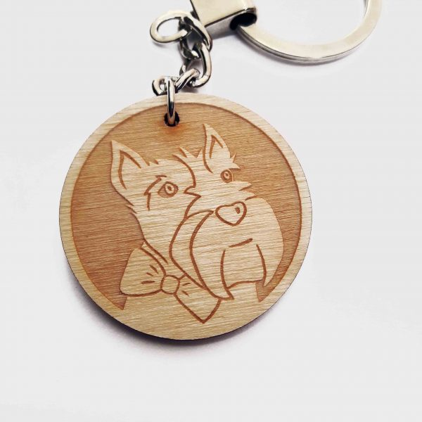 Close up of Scottie Dog keyring, featuring laser engraved face of Scottish Terrier, on wooden disc