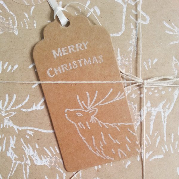 close up of gift wrapped present with Christmas Deer Gift tag