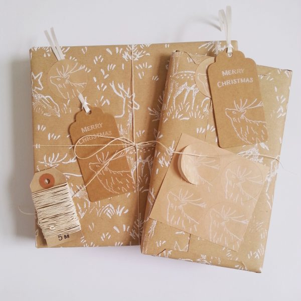 Christmas gifts wrapped in deer print brown kraft wrapping paper