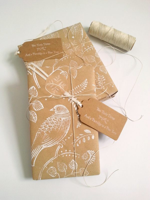 presents wrapped in turtle dove christmas wrapping paper sheet.