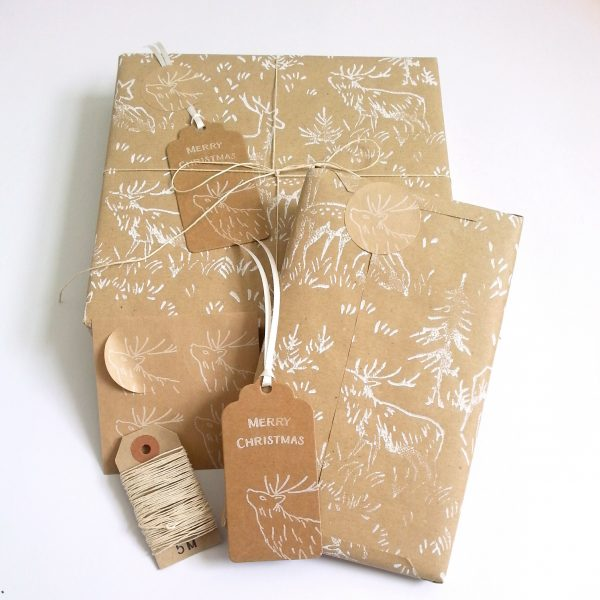 presents wrapped with deer print wrapping paper