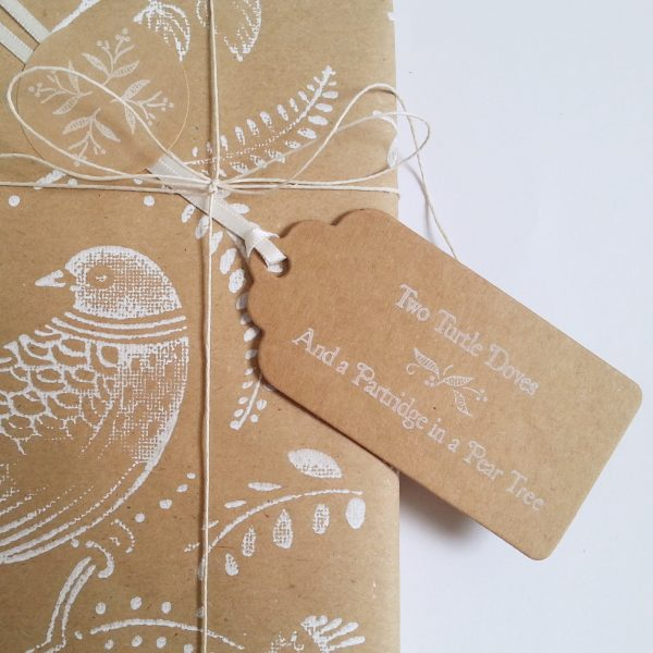 close up of turtle dove wrapping paper with christmas gift tag