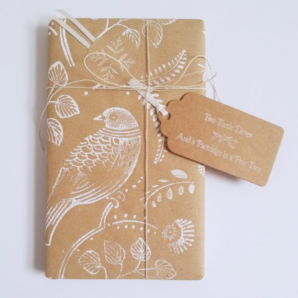 Christmas gift wrapped in turtle dove christmas wrapping papewr - brown kraft with white hand printed bird design