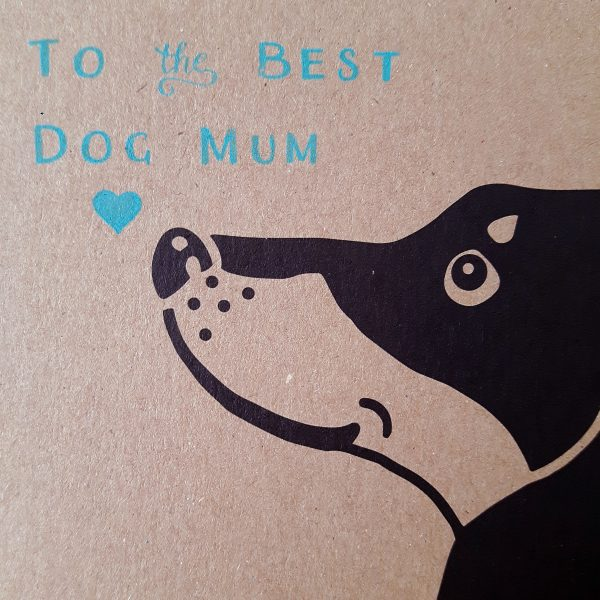 Close up of dachshund mother's day card, brown kraft card with a black dachshund face, and the message 'To the Best Dog Mum'