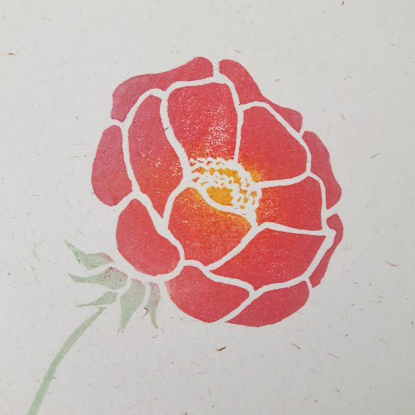 close up of peony print - pink peony on flecked cream card