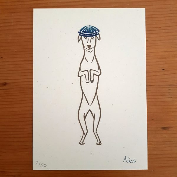 Whippet art print on wooden background. Outline of a standing whippet, holding his paws up as if to beg, and wearing a bright blue flat cap