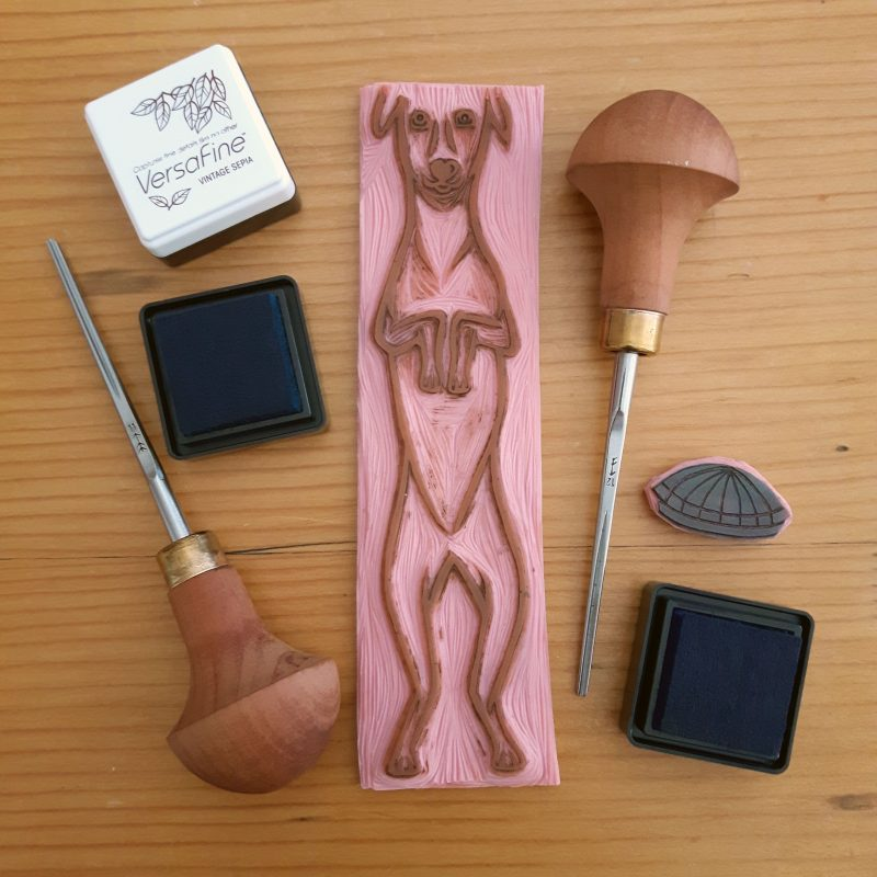 Hand carved block cut of a whippet, with Pfeil carving tools and versafine inks