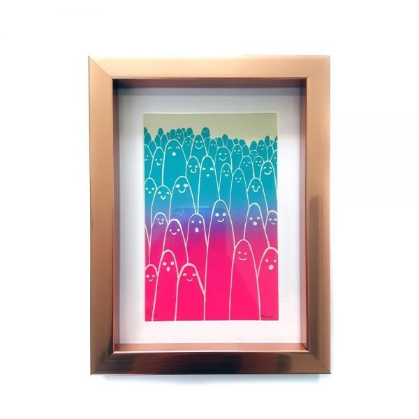 framed art print. Aliens print, with lots of smiling and surprised faces, printed with a gradient effect from turquoise to magenta, and framed ina copper box frame